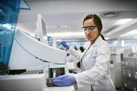 Woman working in medical laboratory